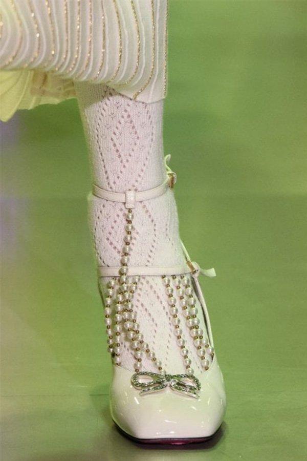 Scarpe Gucci, storia delle perle